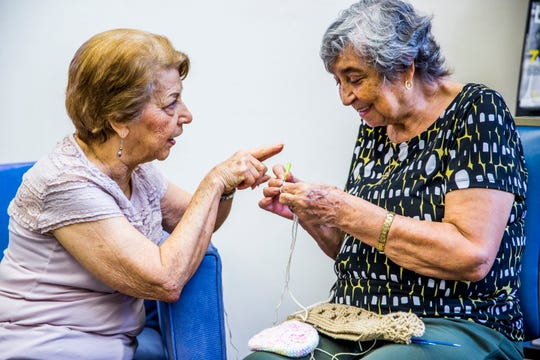 Edi Vargas, 84, left, and Rosa Leon, 84, knit together during the knitting club meeting at Golden Gate Senior Center in Golden Gate on Thursday, Sept. 6, 2018.