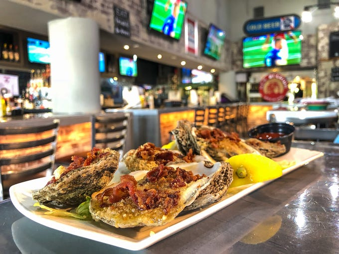"""Pelican Larry's Raw Bar and Grill's """"Casino,"""" Freshly shucked clams or oysters topped with garlic and herb breadcrumbs, butter and bacon. Baked until golden and served with fresh lemon. Pictured is oysters (6) $14.95."""