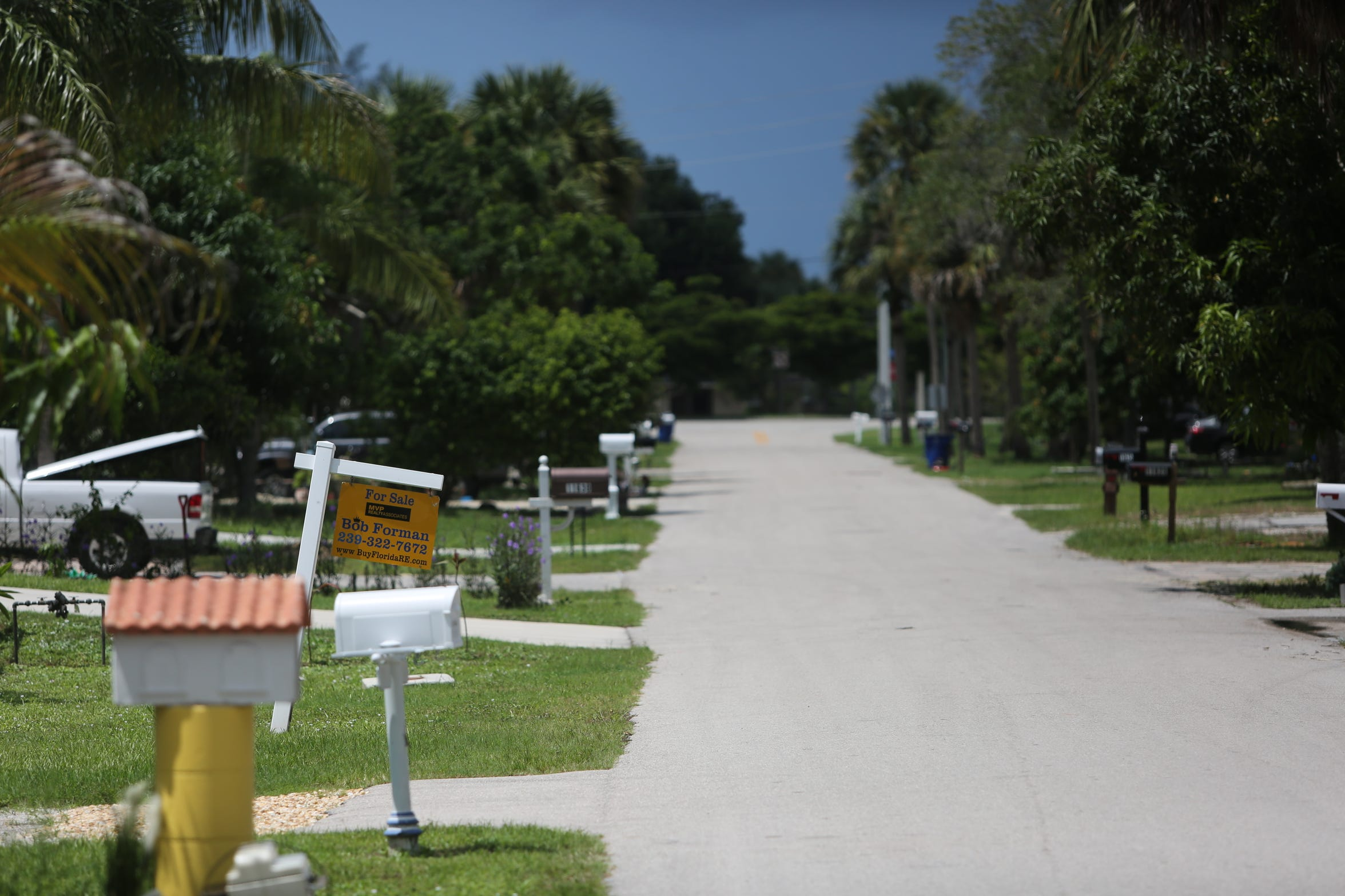 For sale signs are a common sight earlier this month on streets in a Bonita Springs neighborhood that was flooded by Hurricane Irma rains.