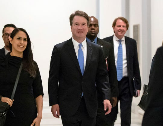 President Donald Trump's Supreme Court nominee, Judge Brett Kavanaugh, arrives to meet with Sen. Chris Coons, D-Del., a member of the Senate Judiciary Committee which will oversee his confirmation, on Capitol Hill in Washington, Thursday, Aug. 23, 2018. White House Counse Don McGahn is at right, rear.