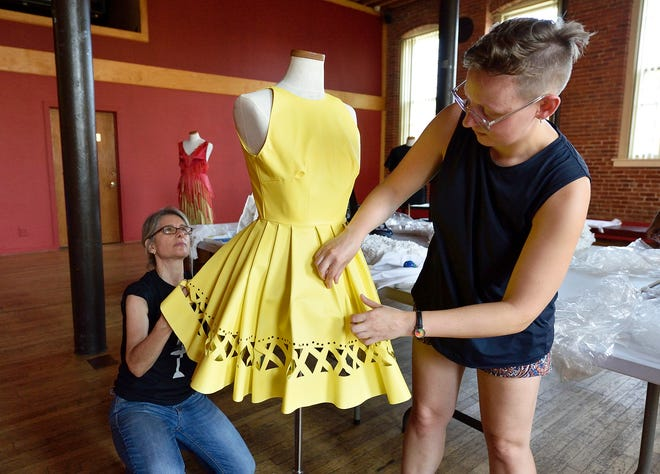 "Paterson Museum exhibit curator Cristina Deutsch and ""trashion"" artist Rose Orelup set up ""Rolling Up Your Blinds"" dress on Thursday. The Eco-Chic 2 exhibit will open on Sept. 16."