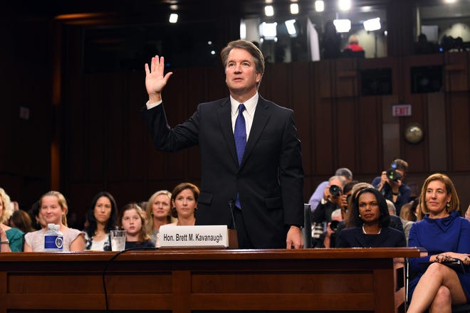 Sep 4, 2018; Washington, DC, USA; Supreme Court Associate Justice nominee Brett Kavanaugh is sworn in as he appears before the Senate Judiciary Committee during his confirmation hearing.