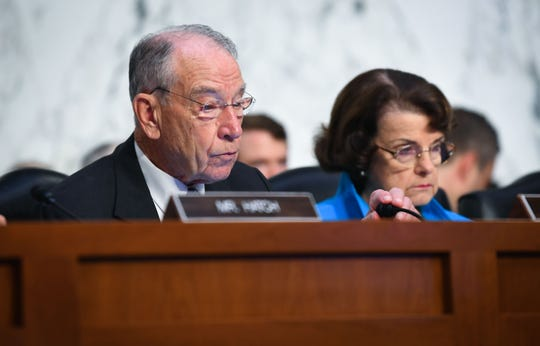 Sep 5, 2018; Washington, DC, USA; Senator Chuck Grassley, chairman of the Senate Judiciary Committee and Senate Judiciary Ranking Member Dianne Feinstein, right, while Supreme Court Associate Justice nominee Brett Kavanaugh appears before the Senate Judiciary Committee during his confirmation hearing.