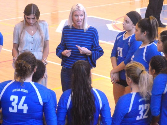Wood-Ridge girls volleyball coach Andrea Marino talks with the Blue Devils during a time out.