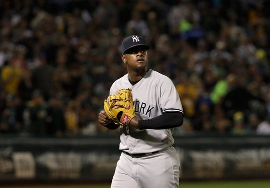 New York Yankees pitcher Luis Severino walks toward the dugout after being relieved during the third inning of a baseball game against the Oakland Athletics in Oakland, Calif., Wednesday, Sept. 5, 2018.