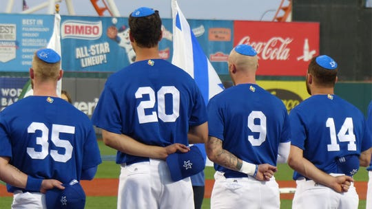 "Team Israel stands for ""Hatikvah"" at World Baseball Classic qualifying game in Brooklyn."