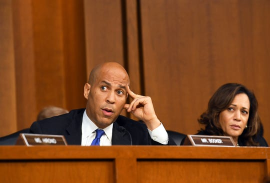 Sen. Cory Booker, D-N.J., left, speaks while Sen. Kamala Harris, D-Calif., listens during the hearing Sept. 4, 2018, in Washington for Supreme Court nominee Brett Kavanaugh.
