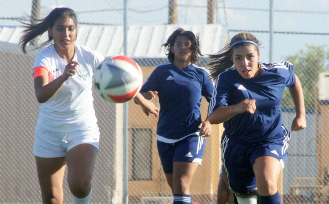 Senior Mireya Trujilo (right) catches up to the lead pass from junior Daniela Aguirre (center) to score her first goal of the season.