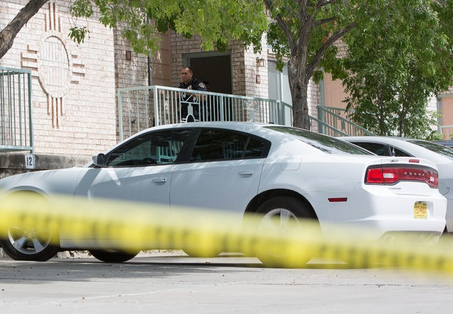 A Las Cruces Police officer stands outside of an apartment unit at Willow Brook Apartments, where crime scene investigators are working inside. Thursday September 6, 2018.