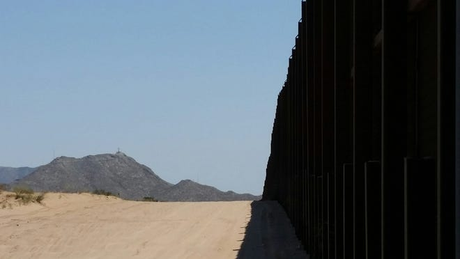 The U.S.-Mexico border fence is seen west of Mount Cristo Rey and Sunland Park on Aug. 14, 2018.