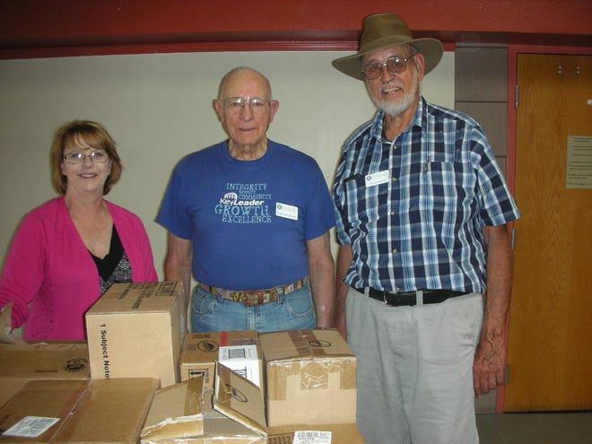 Kiwanis Club of Las Cruces treasurer Jim Vorenberg and past president Grady McCullough deliver school supplies to four elementary schools in need.