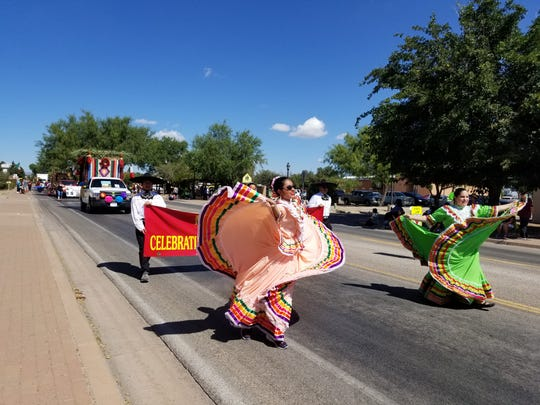 Participants in the Diez y Seis de Septiembre Parade make their way down the streets of Mesilla.