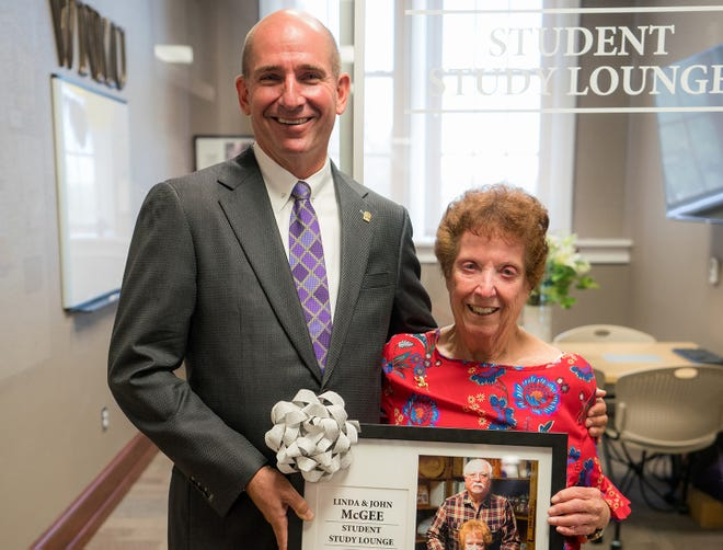 Western New Mexico University President Dr. Joseph Shepard congratulates Linda McGee, who was honored for 40 years of service at WNMU and contributions to the WNMU Foundation, during a naming ceremony on August 17.