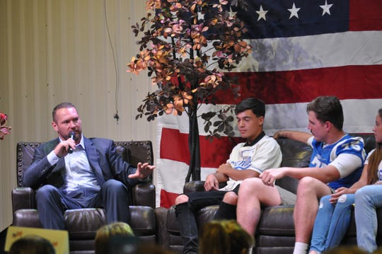 Former Bears linebacker Brian Urlacher takes questions from athletes from Carlsbad High School during the Sep. 6 Mayor's Energy Summit in Carlsbad, New Mexico.