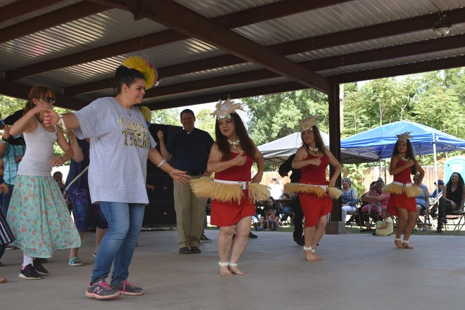 In this 2017 file photo, Desert Star Polynesia Hula and Tahitian dancers from Albuquerque teach residents how to dance at last year's Fiesta de La Luz. This year the festival offers more fun and music Friday and Saturday.