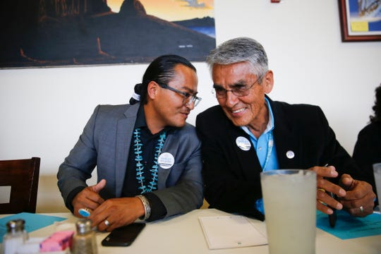 Buu Van Nygren, left and Joe Shirley Jr. talk Wednesday during a campaign dinner at the Nataani Nez Restaurant in Shiprock.