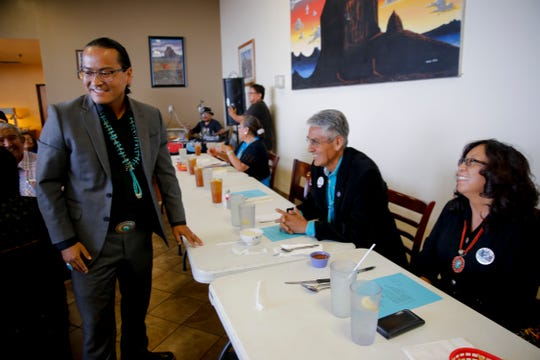 Vice presidential candidate Buu Van Nygren, left, talks with Navajo Nation presidential candidate Joe Shirley Jr. and his wife Vikki Shirley Wednesday during a campaign dinner at the Nataani Nez Restaurant in Shiprock.