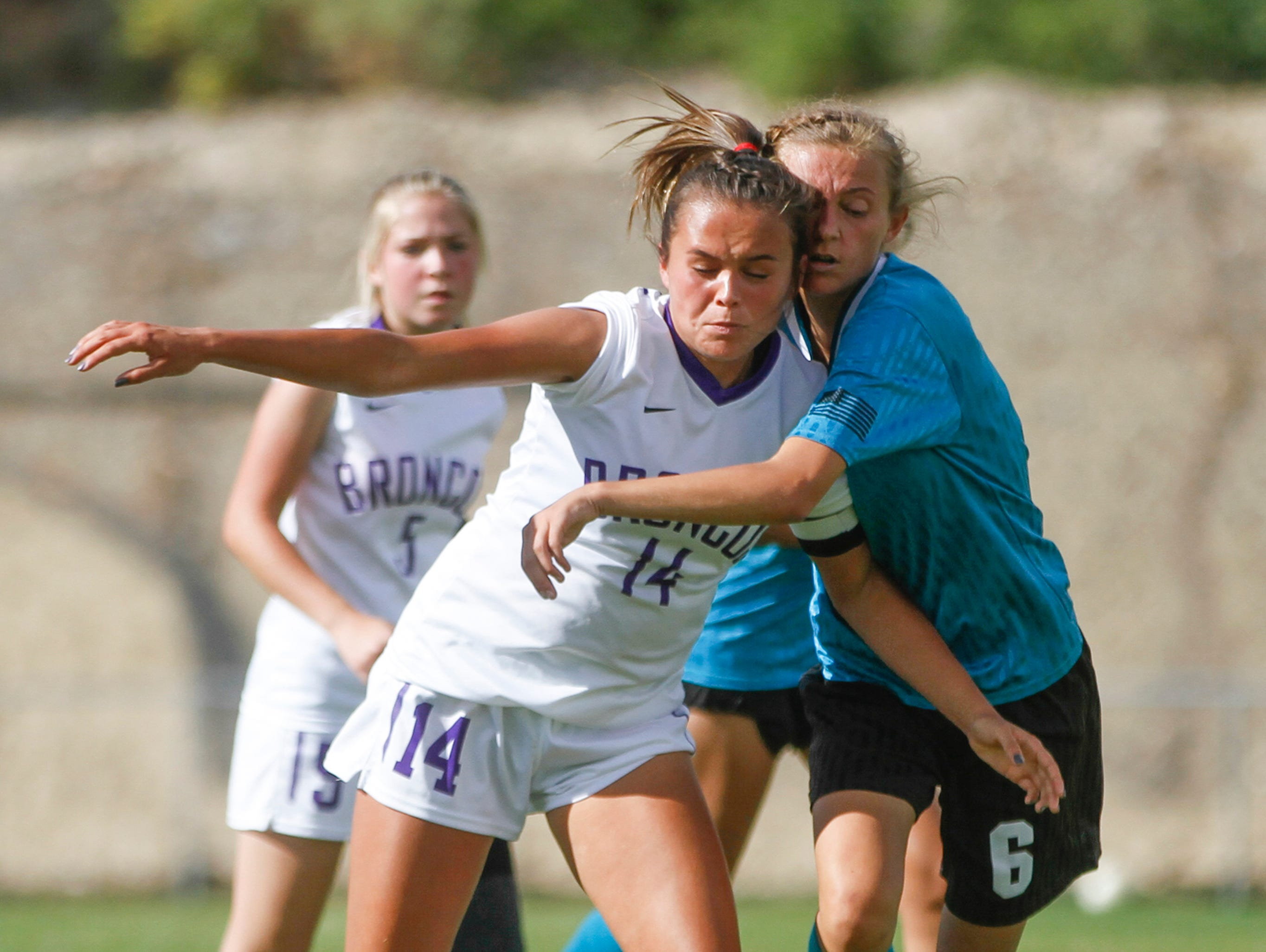 Navajo Prep's Emma Mohs challenges Kirtland Central's Hayden Alldredge for possession on the ball, Thursday, Sept. 6, 2018 at Navajo Prep's Eagle Stadium in Farmington.