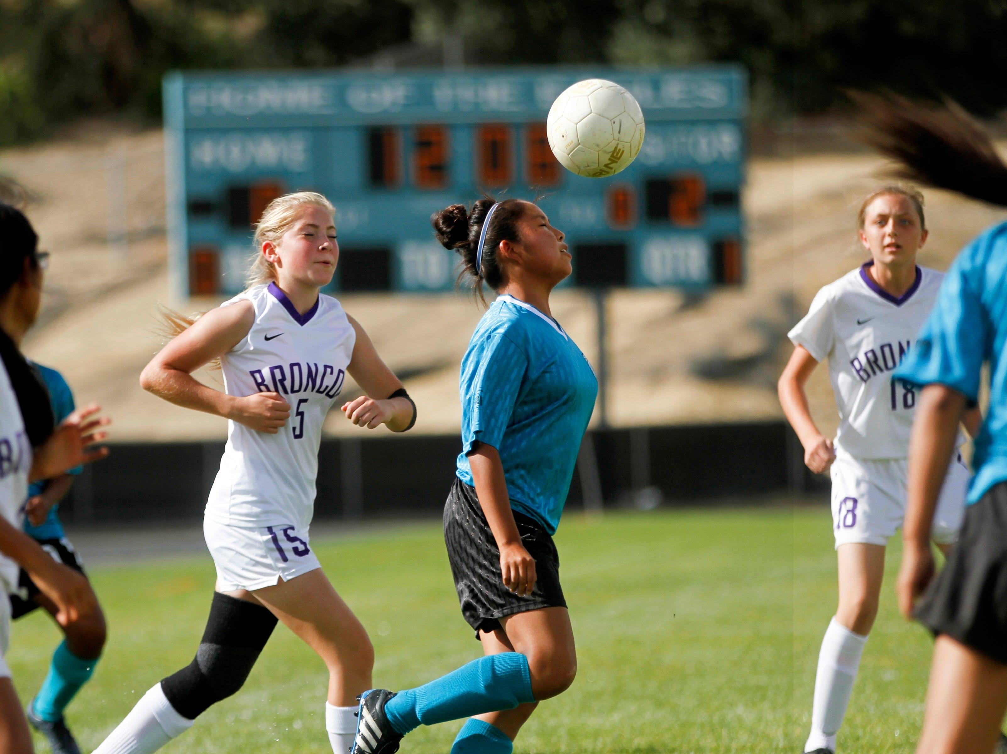 Navajo Prep's Shaynia Jackson gains possession of of the ball, Thursday, Sept. 6, 2018 during their game against Kirtland Central at Navajo Prep's Eagle Stadium in Farmington.