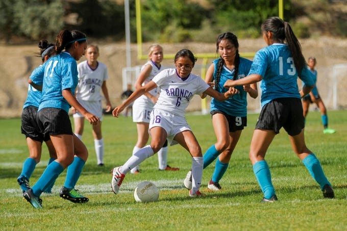 Kirtland Central's Marissa Henry control of the ball during their game against Navajo Prep, Thursday, Sept. 6, 2018 at Eagle Stadium in Farmington.