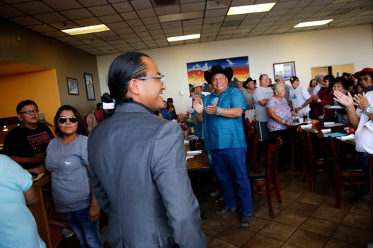 Community members welcome Navajo vice presidential candidate Buu Van Nygren Wednesday during a campaign event at the Nataani Nez Restaurant in Shiprock.