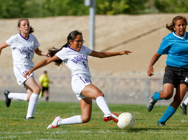 Kirtland Central's Marissa Henry scores a goal against Navajo Prep, Thursday, Sept. 6, 2018 at Navajo Prep's Eagle Stadium in Farmington.
