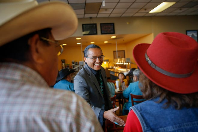 Navajo Nation vice presidential candidate Buu Van Nygren, center, shakes hands with supporters during a campaign dinner Wednesday at the Nataani Nez Restaurant in Shiprock.
