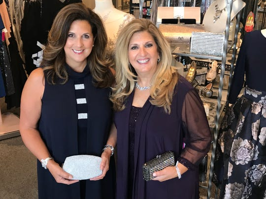 Marisa Miller (left) and Michele Jakacki model more formal clothing donated by The Clothing Cove in Milford.