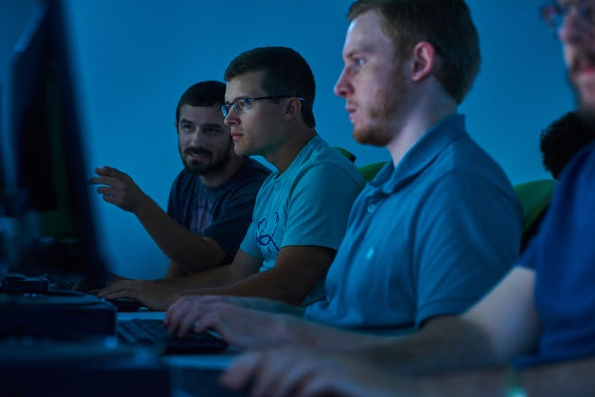 University of West Florida students learn the latest cybersecurity techniques in the Battle Lab in Building 4.