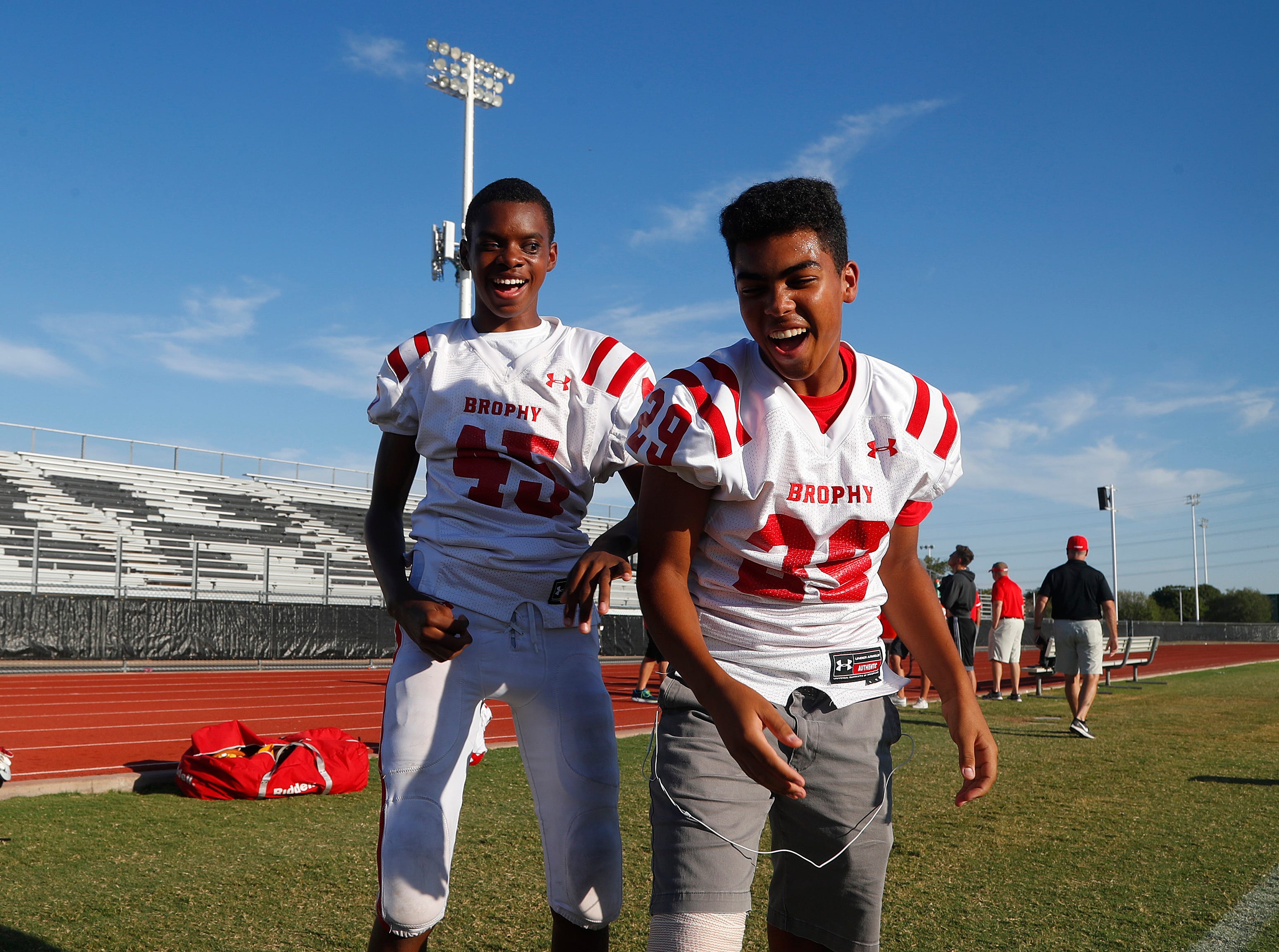 Brophy's Adonis Watt (L) knocks away a pass intended for his teammate Carty Shoen as they have fun before a game against Highland at Highland High School in Gilbert, Ariz. on Aug. 30, 2018.