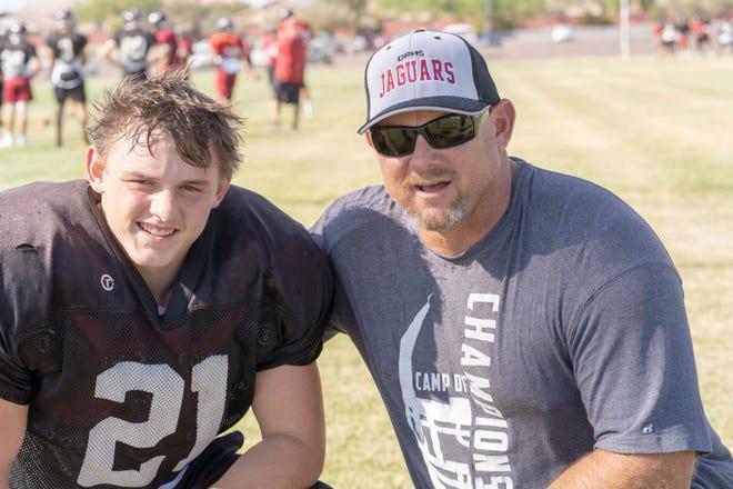 Desert Ridge football head coach Jeremy Hathcock and his son, Koby, a in Mesa, Az.