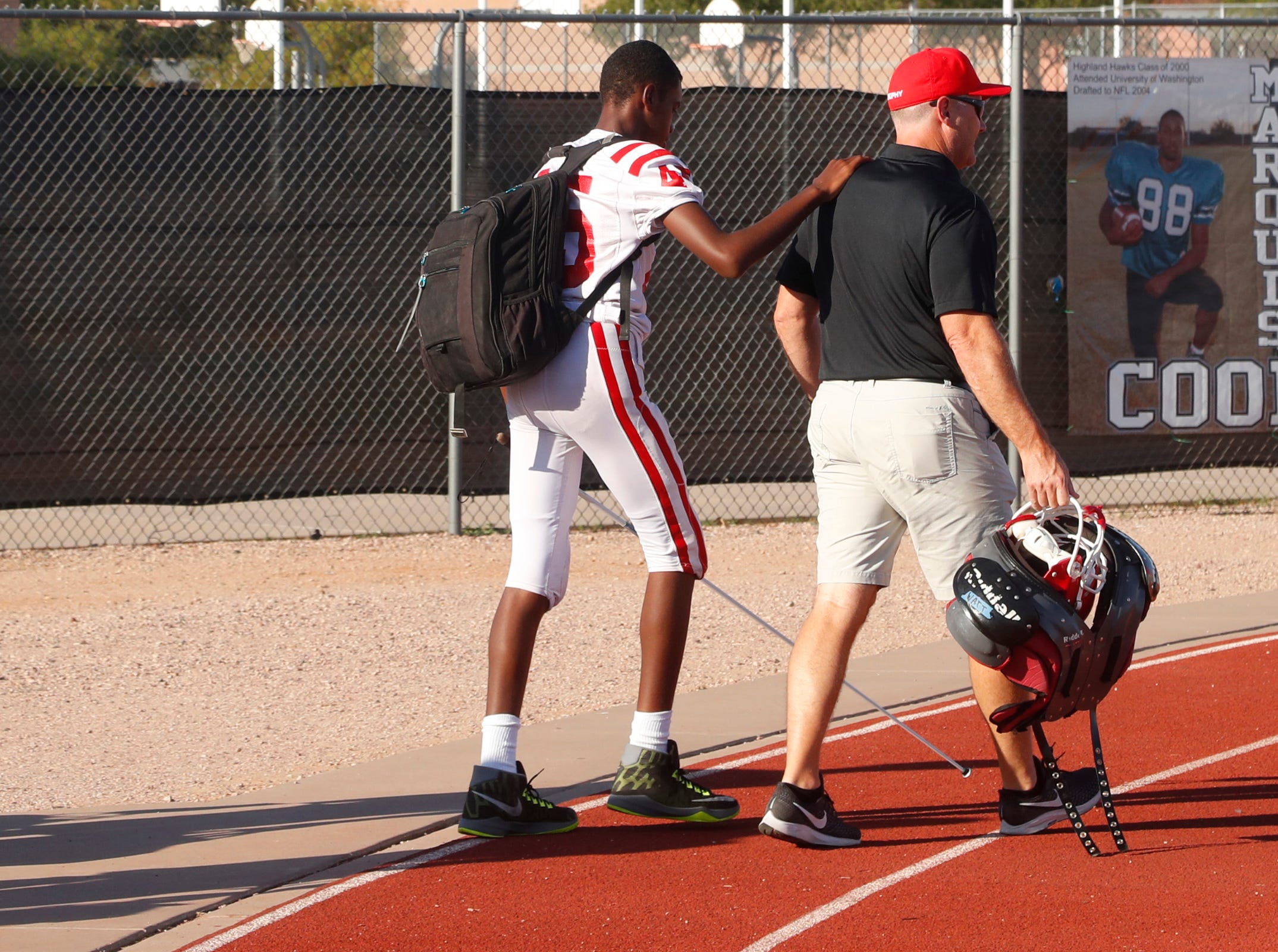 Brophy's Adonis Watt (45) walks in with coaches before a freshmen game against Highland at Highland High School in Gilbert, Ariz. on Aug. 30, 2018.