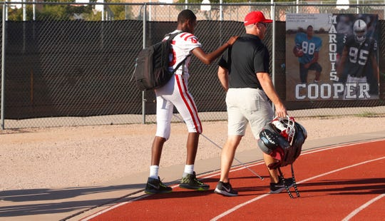 Adonis Watt walks into his game against Highland with coaches on Aug. 30.