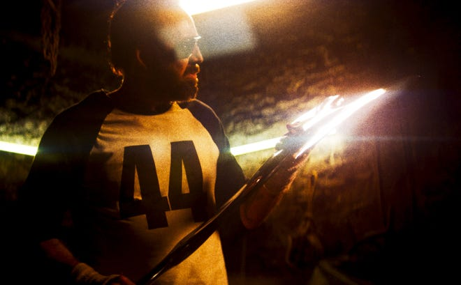 "Red Miller (Nicolas Cage) wields a self-made ax in ""Mandy."""