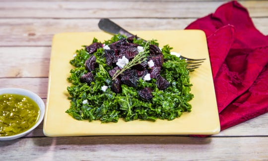 Massaged kale salad with roasted beets and feta in a leek vinaigrette from Robin Miller.