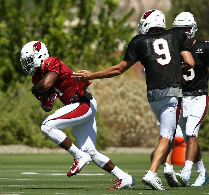 Arizona Cardinals quarterback Sam Bradford (9) hands the ball to running back David Johnson (31) during practice on Sep. 5, 2018 at the Arizona Cardinals Training Facility in Tempe, Ariz.