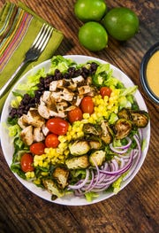 Southwestern grilled chicken salad with roasted brussels sprouts and creamy chipotle dressing from Robin Miller.