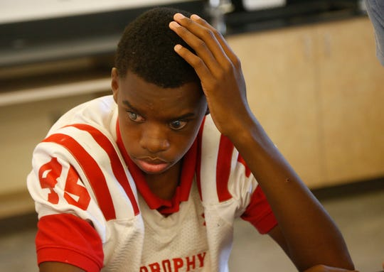 Adonis Watt listens during a freshman biology class on Wednesday.