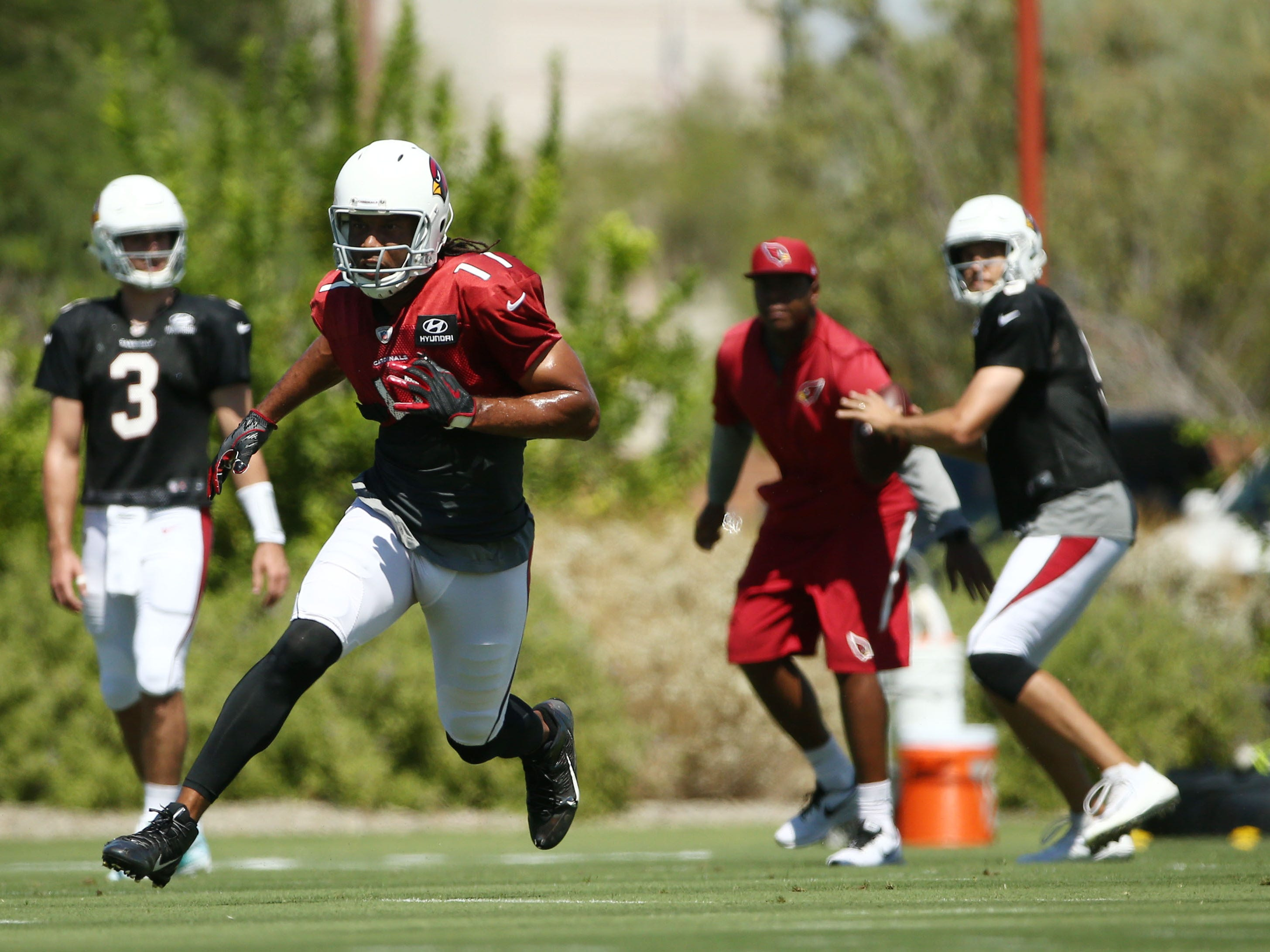 Arizona Cardinals quarterback Sam Bradford throws a pass to wide receiver Larry Fitzgerald during practice on Sep. 5, 2018 at the Arizona Cardinals Training Facility in Tempe, Ariz.