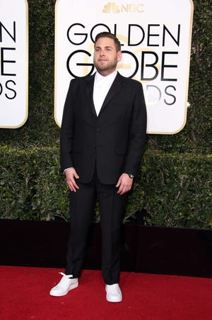 Jonah Hill arrives for the 74th Golden Globe Awards at the Beverly Hilton.
