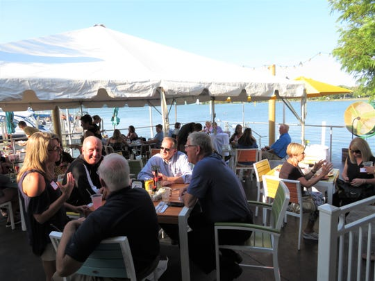 Attendees enjoy an evening of casual dining and networking at The Keys on Put-in-Bay in 2018.