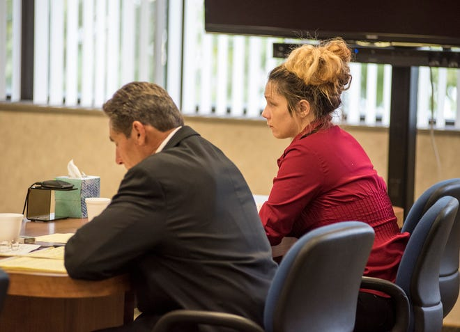 Theresa Gafken, right, sits next to her attorney, Edward Marshall, Thursday, Sept. 6, 2018, while Circuit Judge Michael West addresses jurors during her trial. Gafken, 36, is facing second-degree murder and other charges in a fatal crash that happened April 11.