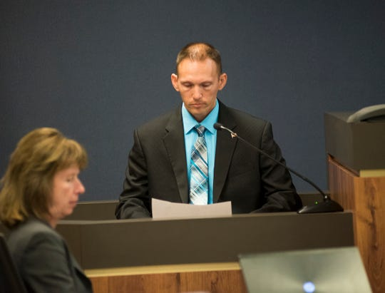 Port Huron Police Officer Donald Ochadleus reviews evidence Thursday, Sept. 6, 2018 in the trial for Theresa Gafken in Circuit Judge Michael West's courtroom.