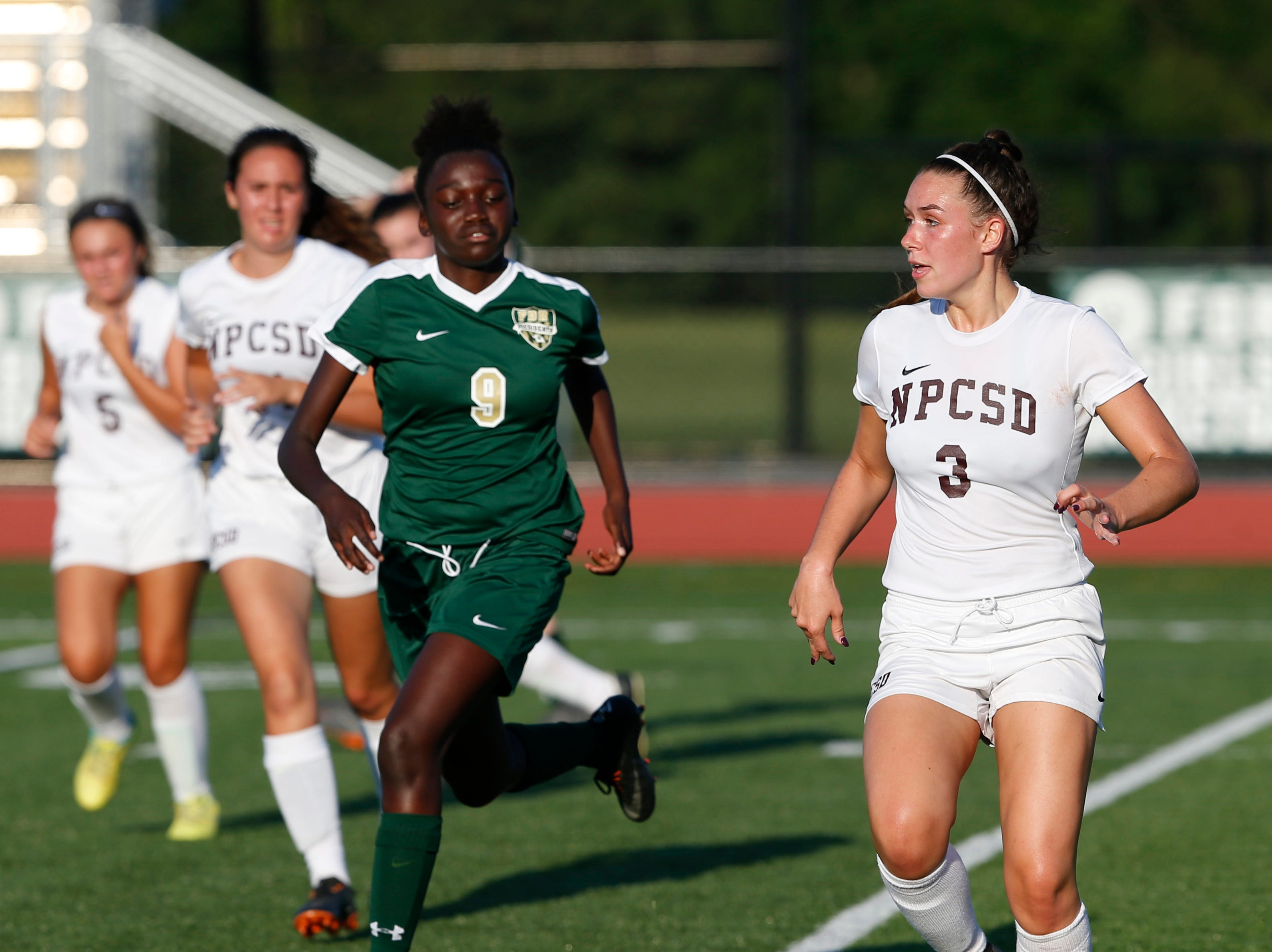 New Paltz's Taylor Bruck looks to pass the ball ahead of FDR's Marissa Velez during Wednesday's game in Hyde Park on September 5, 2018.