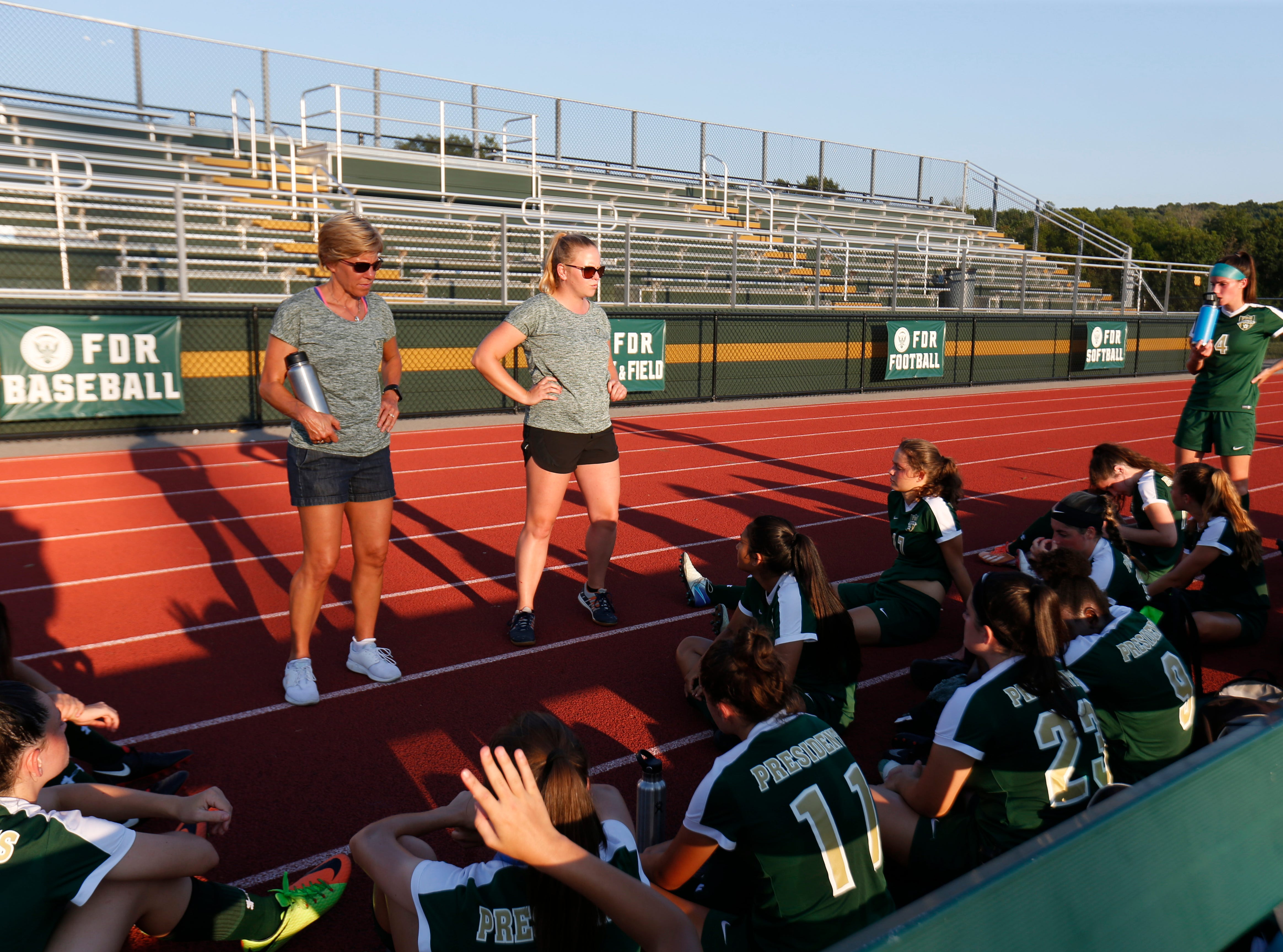 FDR's Barb Demczar and Kristi Lee Hendricks talk to their players during half-time in Wednesday's game versus New Paltz in Hyde Park on September 5, 2018.
