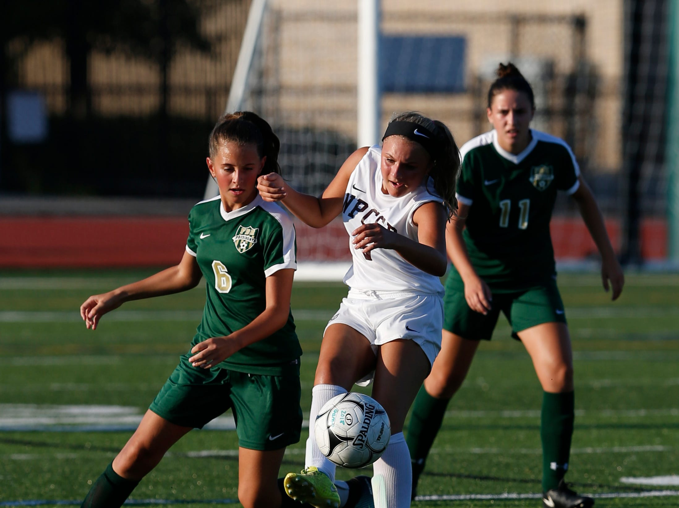 New Paltz's Maddy Garcia clears the ball away from FDR's Emma Rasco during Wednesday's game in Hyde Park on September 5, 2018.