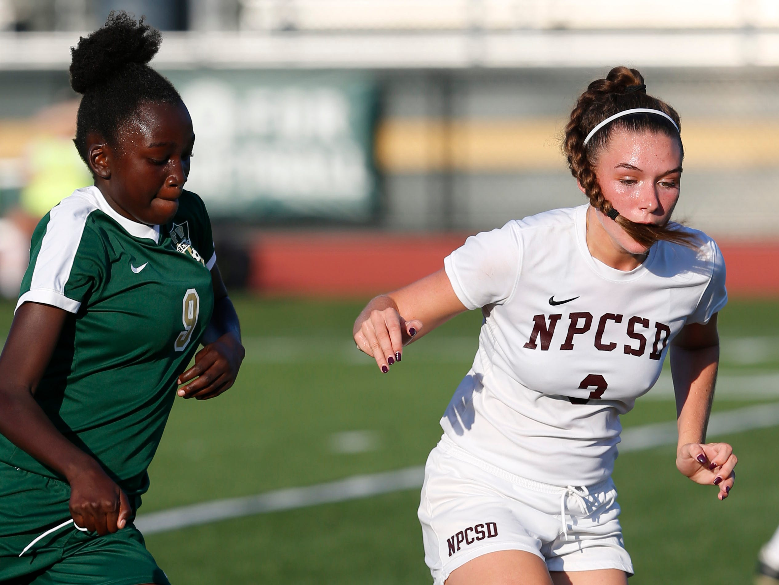 New Paltz's Taylor Bruck leads the ball away from FDR's Marissa Velez during Wednesday's game in Hyde Park on September 5, 2018.