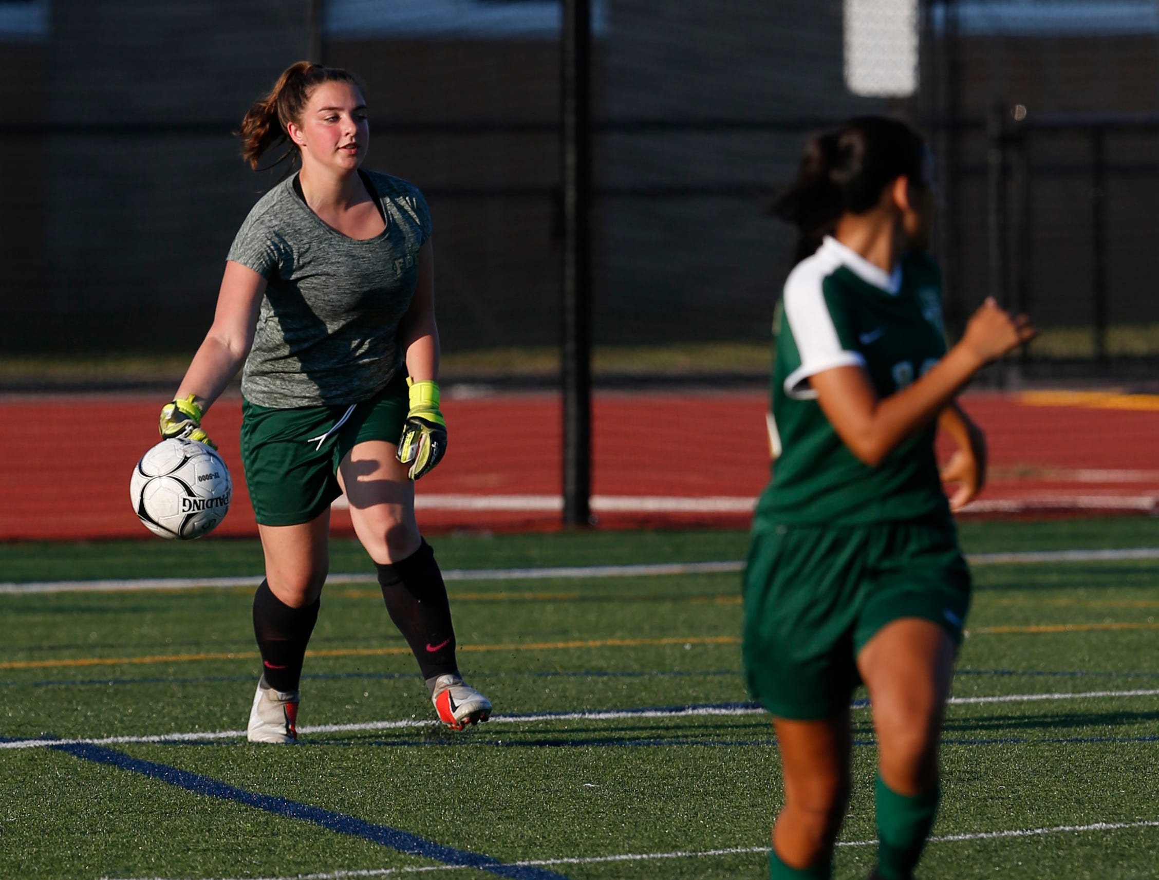FDR's Alana Cathcart throws the ball back into play during Wednesday's game in Hyde Park on September 5, 2018.