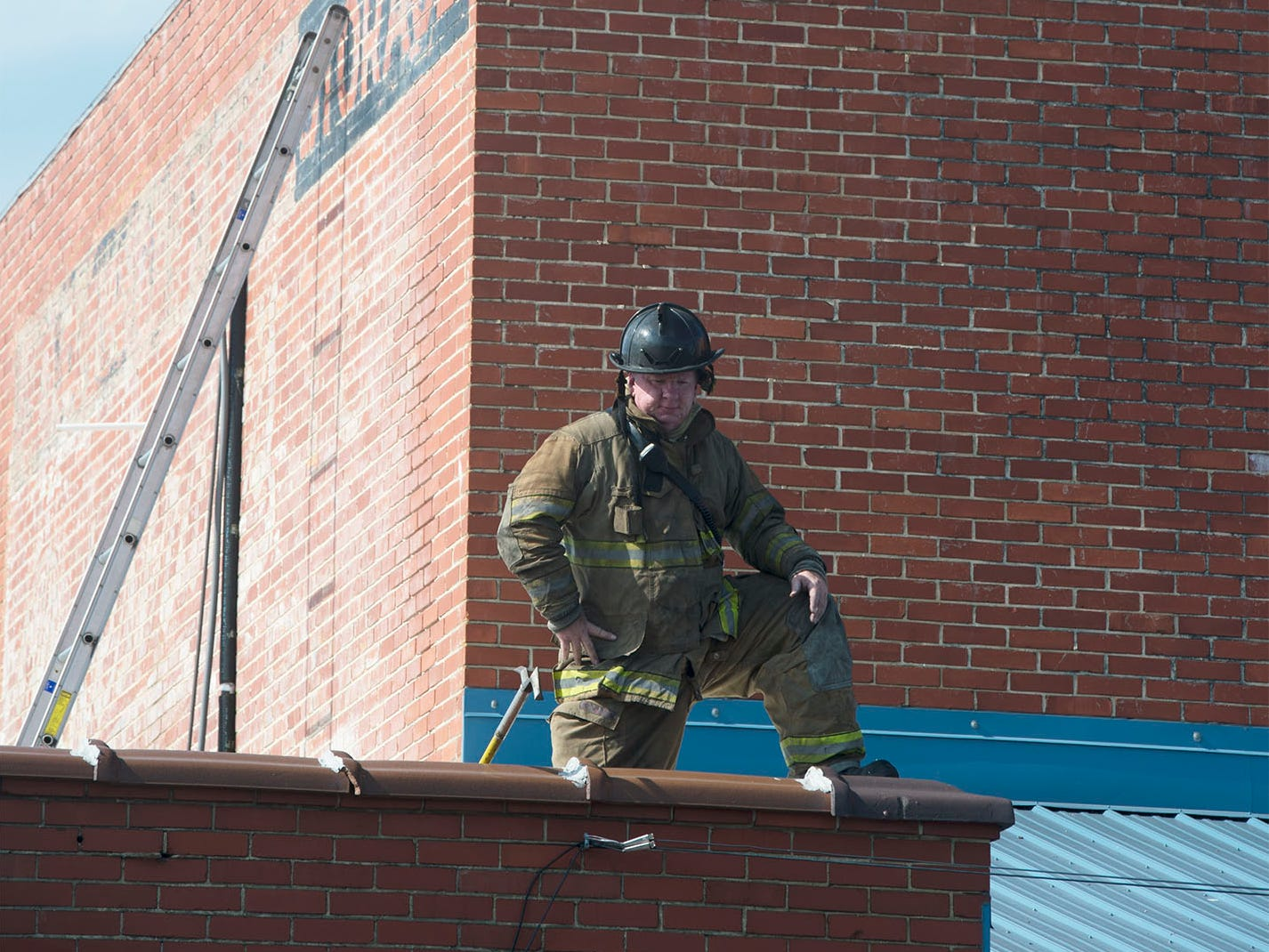 Firefighters are on the roof of Zero Ice. Firefighters are at Zero Ice Corp., 42 Siloam Road, Chambersburg, for a reported fire in the building on Thursday morning, Sept. 6, 2018. The fire was contained to the interior of the building.