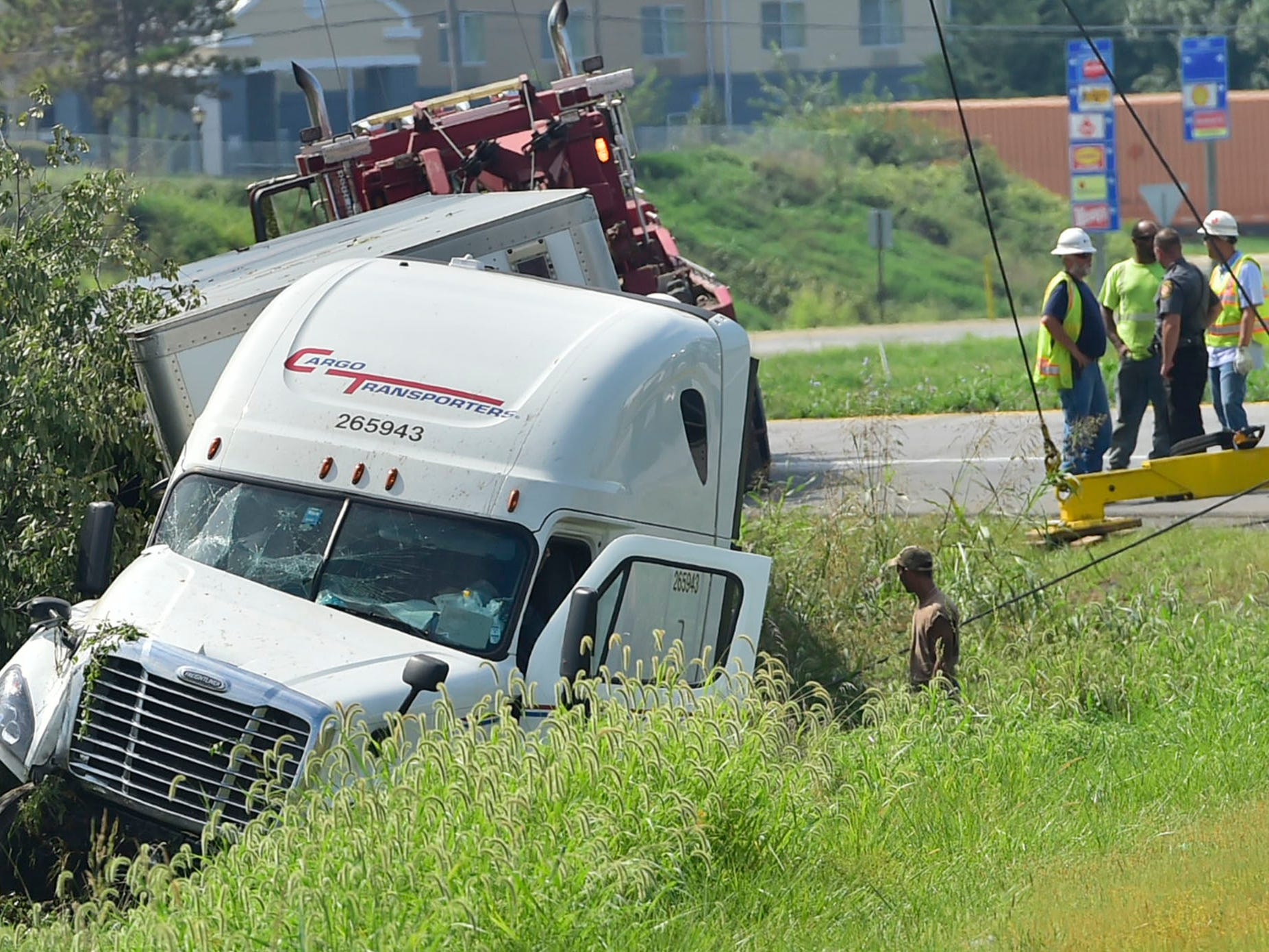 A tractor-trailer rests in a ditch following an accident at Interstate 81 at  northbound Exit 14, Chambersburg. The accident occured around 10:30am Thursday Sept. 6, 2018.